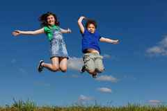 Kids jumping outdoor Royalty Free Stock Photography