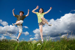 Kids jumping outdoor. Kids jumping against blue sky Royalty Free Stock Photo