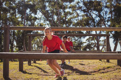 Kids jumping over the hurdles during obstacle course training Stock Photo