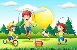 Kids jumping rope in the park Royalty Free Stock Images