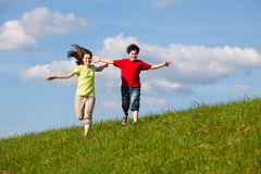Kids jumping, running outdoor Royalty Free Stock Image
