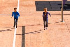 Kids jumping, running outdoor at sunny day. Happy kids jumping, running outdoor at sunny day Royalty Free Stock Photos