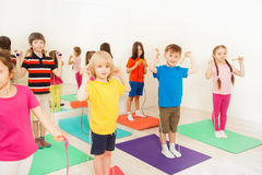 Kids jumping with skipping rope in fitness class Stock Photography