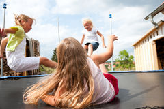 Kids jumping on trampoline Stock Image