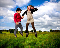 Kids jumping Royalty Free Stock Images