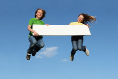 Free Kids Jumping With Blank Sign Royalty Free Stock Photo - 8298225