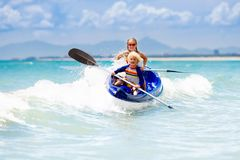 Free Kids Kayaking In Ocean. Children In Kayak In Tropical Sea Royalty Free Stock Photography - 109217137