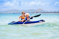 Kids kayaking in ocean. Children in kayak in tropical sea Royalty Free Stock Photography
