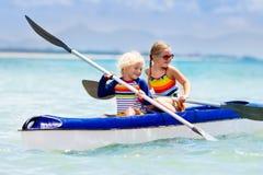 Kids kayaking in ocean. Children in kayak in tropical sea Royalty Free Stock Image