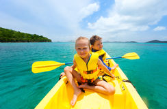 Kids kayaking in ocean Royalty Free Stock Photos