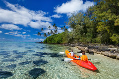 Kids kayaking in ocean Royalty Free Stock Image