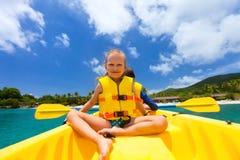 Kids kayaking in ocean Royalty Free Stock Photo