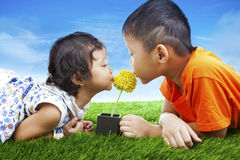 Kids kissing flower Stock Images