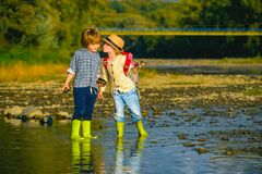 Free Kids Kissing. Traveler Hiking In The Mountains River. Summer And Water Fun. Travel With Kids. Love, Trust And Tenderness Royalty Free Stock Image - 175126586