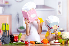 Kids in the kitchen starts to cook, watch recipe Royalty Free Stock Photography