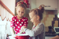 Kids at the kitchen Stock Images