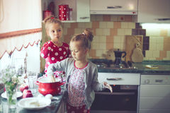 Kids at the kitchen Stock Photography