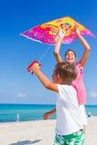 Kids with kite Stock Image