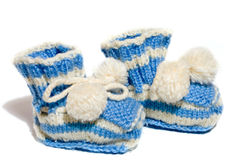Kids knit baby's bootees Stock Photos