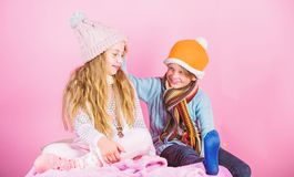 Kids knitted winter hats. Winter accessories for kids. Girl and boy wear knitted winter hats. Winter season fashion. Accessories and clothes. Children playful royalty free stock photography
