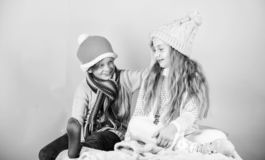 Kids knitted winter hats. Winter accessories for kids. Girl and boy wear knitted winter hats. Winter season fashion. Accessories and clothes. Children playful royalty free stock photo