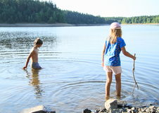 Kids in a lake Royalty Free Stock Photography