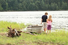 Kids by a lake Stock Image