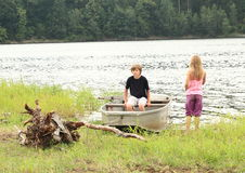 Kids by a lake Stock Photos