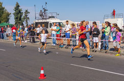 Kids lap in Run for Life competition during City Day local activity. DNEPROPETROVSK, UKRAINE - SEPTEMBER 12, 2015: Kids lap in Run for Life competition during Stock Photos