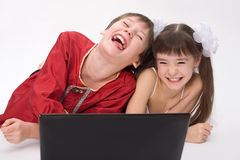 Kids with laptop. Girl and boy Stock Photography