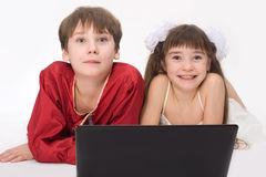 Kids with laptop. Girl and boy Royalty Free Stock Images