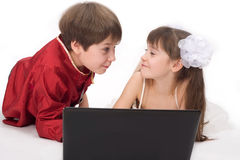 Kids with laptop. Girl and boy Stock Photo