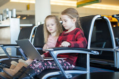 Kids with a laptop at the airport while waiting Royalty Free Stock Photo
