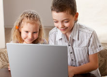 Kids with laptop Royalty Free Stock Photos