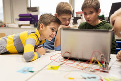 Kids, laptop and invention kit at robotics school. Education, children, technology, science and people concept - group of happy kids with laptop computer playing stock image