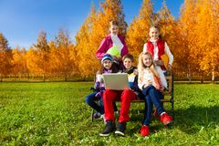 Kids with laptop and papers Stock Photo