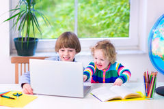 Kids with a laptop Royalty Free Stock Image
