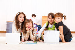 Kids with laptops royalty free stock photography