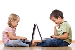 Kids with laptops Royalty Free Stock Image