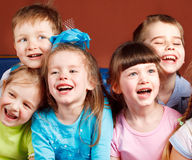Kids laughing. Group of five preschool kids laughing Stock Photography