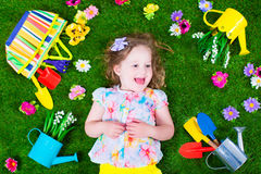 Kids on a lawn with garden tools Stock Photos