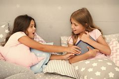 Free Kids Lay In Bed Fight For Book. Friends Have Some Problems. Steps For Dealing With Sibling Rivalry. There Is No Harm In Stock Image - 151982631