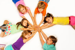 Kids lay in star shape Royalty Free Stock Images