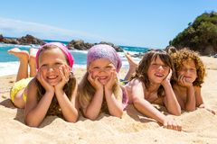 Kids laying on the beach. Royalty Free Stock Photography