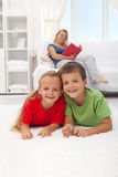 Kids laying on the floor in the living room Royalty Free Stock Photography