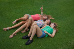 Kids laying on grass in summer Royalty Free Stock Photos