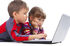 Kids laying with notebook Royalty Free Stock Image