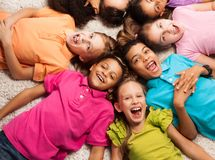 Kids laying in star shape Royalty Free Stock Images