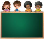 Kids leaning over the empty blackboard Stock Photo