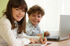 Kids learning. Yong girl and boy learning in classroom Royalty Free Stock Images